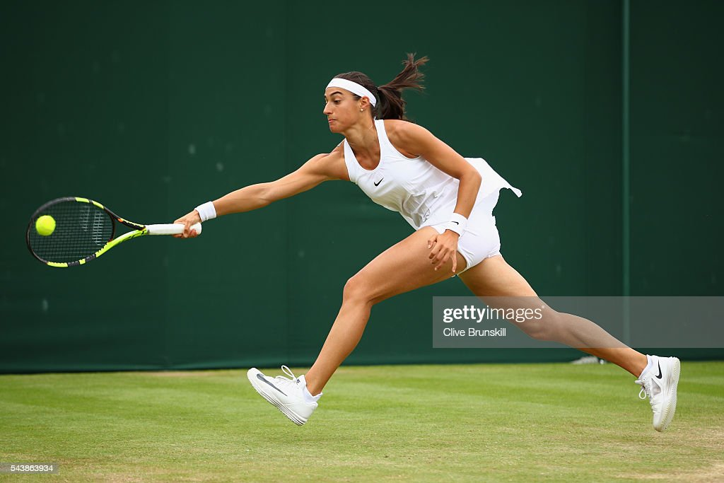 <a gi-track='captionPersonalityLinkClicked' href=/galleries/search?phrase=Caroline+Garcia&family=editorial&specificpeople=6605758 ng-click='$event.stopPropagation()'>Caroline Garcia</a> of France plays a forehand during the Ladies Singles second round match against Katerina Siniakova of The Czech Republic on day four of the Wimbledon Lawn Tennis Championships at the All England Lawn Tennis and Croquet Club on June 30, 2016 in London, England.