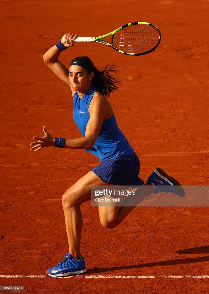 <a gi-track='captionPersonalityLinkClicked' href=/galleries/search?phrase=Caroline+Garcia&family=editorial&specificpeople=6605758 ng-click='$event.stopPropagation()'>Caroline Garcia</a> of France plays a forehand during the Women's Singles second round match against Agnieszka Radwanska of Poland on day four of the 2016 French Open at Roland Garros on May 25, 2016 in Paris, France.