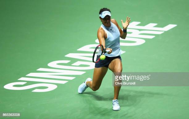 Caroline Garcia of France plays a forehand in her singles match against Simona Halep of Romania during day 2 of the BNP Paribas WTA Finals Singapore...