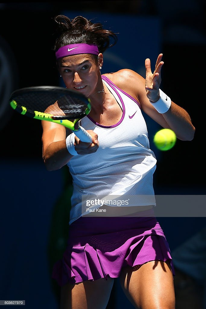 <a gi-track='captionPersonalityLinkClicked' href=/galleries/search?phrase=Caroline+Garcia&family=editorial&specificpeople=6605758 ng-click='$event.stopPropagation()'>Caroline Garcia</a> of France plays a forehand to Sabine Lisicki of Germany in the womens singles match during day four of the 2016 Hopman Cup at Perth Arena on January 6, 2016 in Perth, Australia.