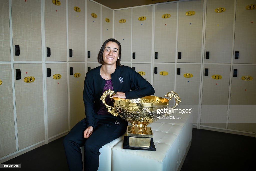 Caroline Garcia of France poses for a picture in the locker room with the winner's trophy after winning the Women's Singles final against Simona Halep of Romania on day nine of the 2017 China Open at the China National Tennis Centre on October 8, 2017 in Beijing, China.