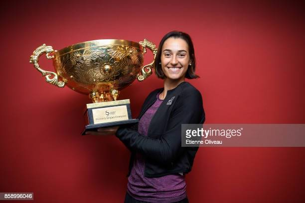 Caroline Garcia of France poses for a picture with the winners trophy after winning the Women's Singles final against Simona Halep of Romania on day...