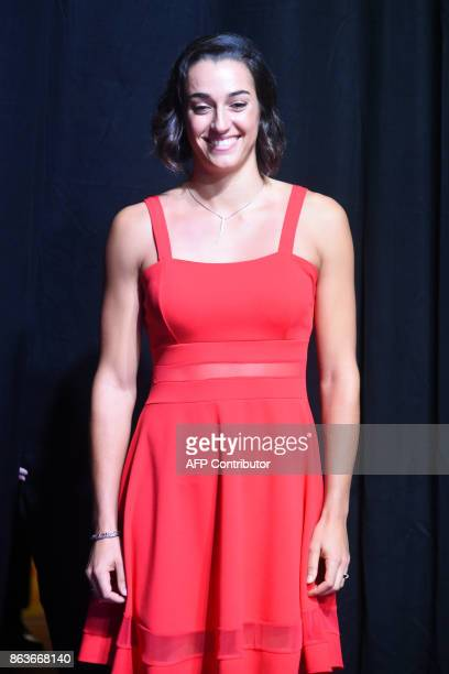 Caroline Garcia of France poses for photographers duirng the Official Draw Ceremony of the WTA Finals Singapore on October 20 2017 The WTA Finals...