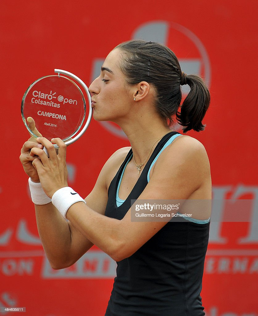 <a gi-track='captionPersonalityLinkClicked' href=/galleries/search?phrase=Caroline+Garcia&family=editorial&specificpeople=6605758 ng-click='$event.stopPropagation()'>Caroline Garcia</a> of France poses with her trophy after defeating Jelena Jakovic of Serbia 6-3, 6-4, during their WTA Bogota Open final match at El Rancho Club on April 13, 2014 in Bogota, Colombia.