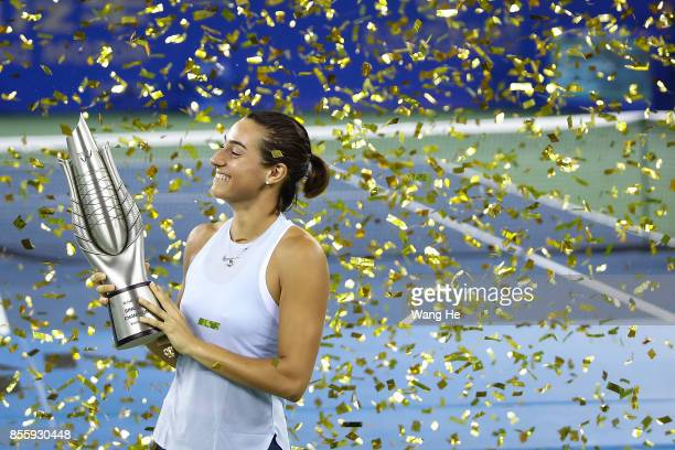 Caroline Garcia of France poses with her trophy after defeating Ashleigh Barty of Australia in the Finals match of Women's Single of 2017 Wuhan Open...