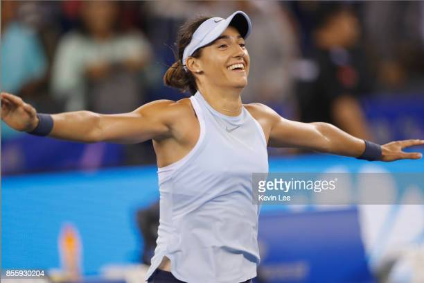 Caroline Garcia of France reacts after defeating Ashleigh Barty of Australia in the Finals match of Women's Single of 2017 Wuhan Open on September 30...