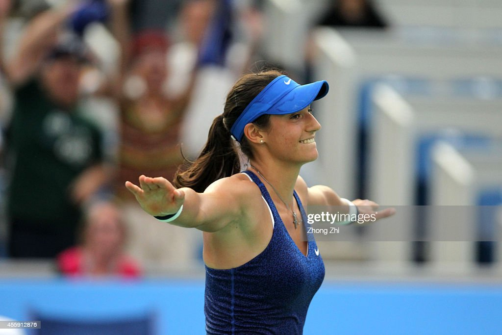 <a gi-track='captionPersonalityLinkClicked' href=/galleries/search?phrase=Caroline+Garcia&family=editorial&specificpeople=6605758 ng-click='$event.stopPropagation()'>Caroline Garcia</a> of France reacts after winning her match against Agnieszka Radwanska of Poland on day two of 2014 Dongfeng Motor Wuhan Open at Optics Valley International Tennis Center on September 22, 2014 in Wuhan, China.