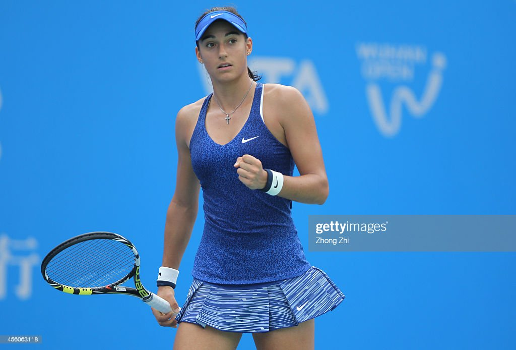 <a gi-track='captionPersonalityLinkClicked' href=/galleries/search?phrase=Caroline+Garcia&family=editorial&specificpeople=6605758 ng-click='$event.stopPropagation()'>Caroline Garcia</a> of France reacts during her match against Petra Kvitova of the Czech Republic on day five of 2014 Dongfeng Motor Wuhan Open at Optics Valley International Tennis Center on September 25, 2014 in Wuhan, China.