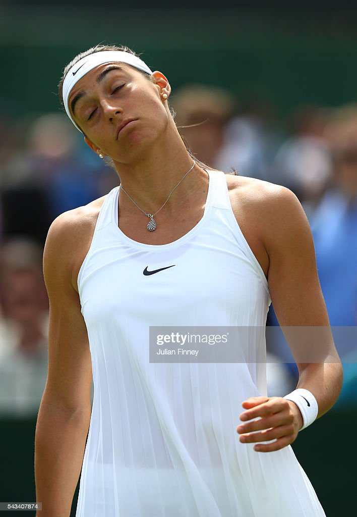 <a gi-track='captionPersonalityLinkClicked' href=/galleries/search?phrase=Caroline+Garcia&family=editorial&specificpeople=6605758 ng-click='$event.stopPropagation()'>Caroline Garcia</a> of France reacts during the Ladies Singles first round match against Cagla Buyukakcay of Turkey on day two of the Wimbledon Lawn Tennis Championships at the All England Lawn Tennis and Croquet Club on June 28, 2016 in London, England.