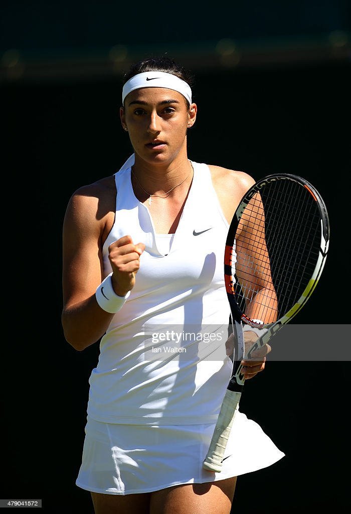 <a gi-track='captionPersonalityLinkClicked' href=/galleries/search?phrase=Caroline+Garcia&family=editorial&specificpeople=6605758 ng-click='$event.stopPropagation()'>Caroline Garcia</a> of France reacts in her Ladies Singles first round match against Heather Watson of Great Britain during day two of the Wimbledon Lawn Tennis Championships at the All England Lawn Tennis and Croquet Club on June 30, 2015 in London, England.