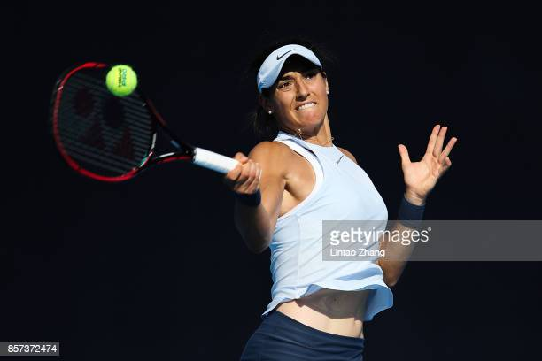 Caroline Garcia of France returns a shot against Elise Mertens of Belgium during the Women's singles second round on day five of 2017 China Open at...