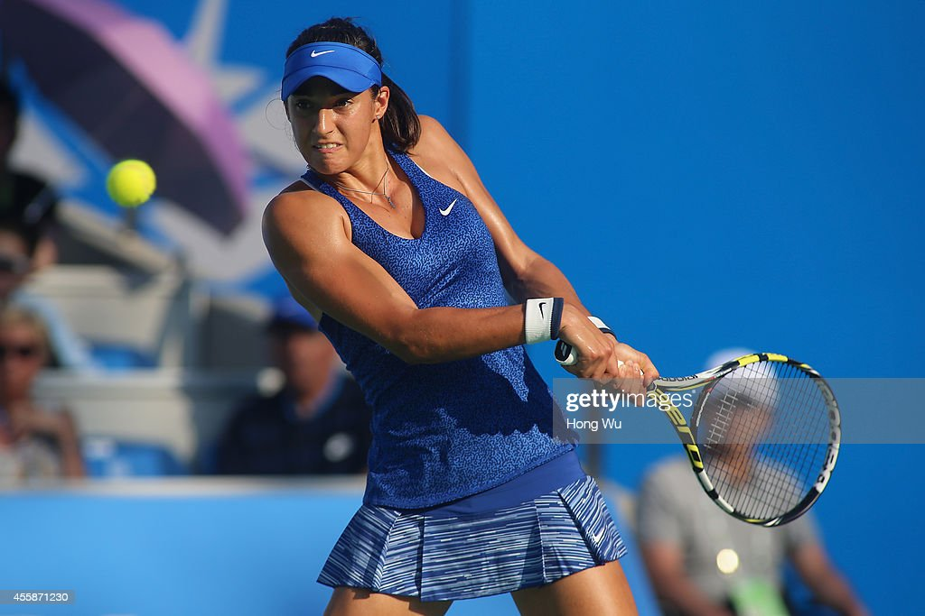 <a gi-track='captionPersonalityLinkClicked' href=/galleries/search?phrase=Caroline+Garcia&family=editorial&specificpeople=6605758 ng-click='$event.stopPropagation()'>Caroline Garcia</a> of France returns a shot during her match against Venus Williams of USA during day one of the 2014 Dongfeng Motor Wuhan Open at Wuhan Guanggu International Tennis Center on September 21, 2014 in Wuhan, China.