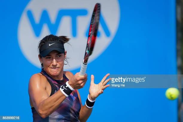 Caroline Garcia of France returns a shot during the match against Chrisitina Mchale of USA on Day 3 of 2017 Dongfeng Motor Wuhan Open at Optics...