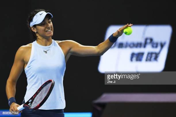 Caroline Garcia of France returns a shot during the Women's singles Quarterfinals match against Elina Svitolina of Ukraine on day seven of 2017 China...
