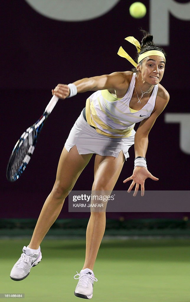Caroline Garcia of France returns the ball to Fatma al-Nabhani of Oman during their match on the first day of the WTA Qatar Open in the capital Doha, on February 11, 2013.