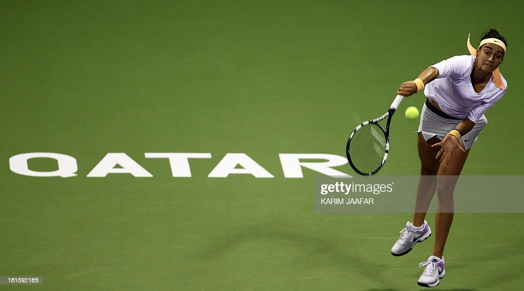 Caroline Garcia of France returns the ball to Maria Sharapova of Russia during their match on the second day of the WTA Qatar Open in the capital Doha, on February 12, 2013.
