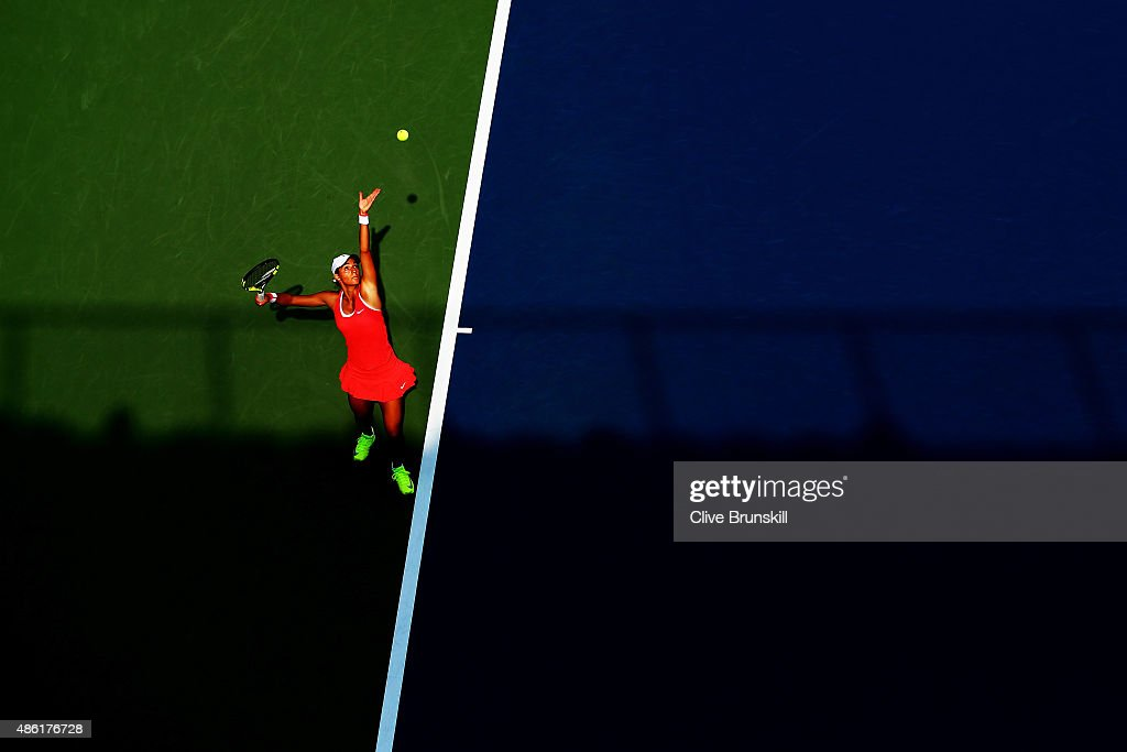 <a gi-track='captionPersonalityLinkClicked' href=/galleries/search?phrase=Caroline+Garcia&family=editorial&specificpeople=6605758 ng-click='$event.stopPropagation()'>Caroline Garcia</a> of France serves against Andrea Petkovic of Germany during their Women's Singles First Round match on Day Two of the 2015 US Open at the USTA Billie Jean King National Tennis Center on September 1, 2015 in the Flushing neighborhood of the Queens borough of New York City.