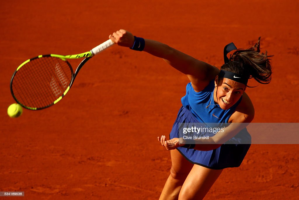 <a gi-track='captionPersonalityLinkClicked' href=/galleries/search?phrase=Caroline+Garcia&family=editorial&specificpeople=6605758 ng-click='$event.stopPropagation()'>Caroline Garcia</a> of France serves during the Women's Singles second round match against Agnieszka Radwanska of Poland on day four of the 2016 French Open at Roland Garros on May 25, 2016 in Paris, France.