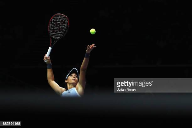 Caroline Garcia of France serves in her singles match against Simona Halep of Romania during day 2 of the BNP Paribas WTA Finals Singapore presented...