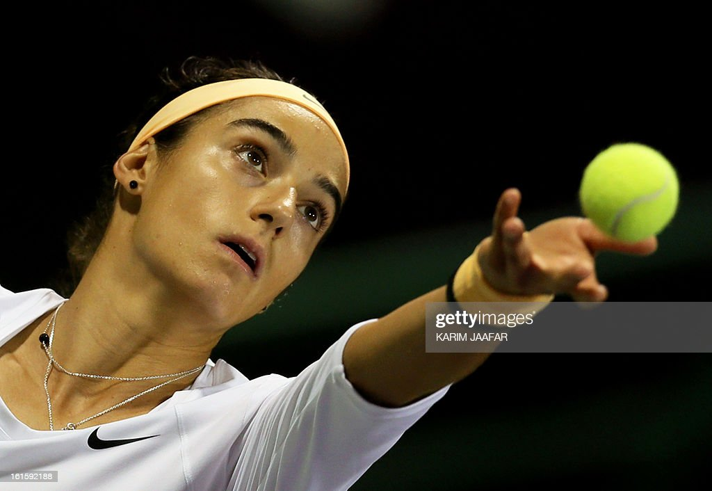 Caroline Garcia of France serves the ball to Maria Sharapova of Russia during their match on the second day of the WTA Qatar Open in the capital Doha, on February 12, 2013.