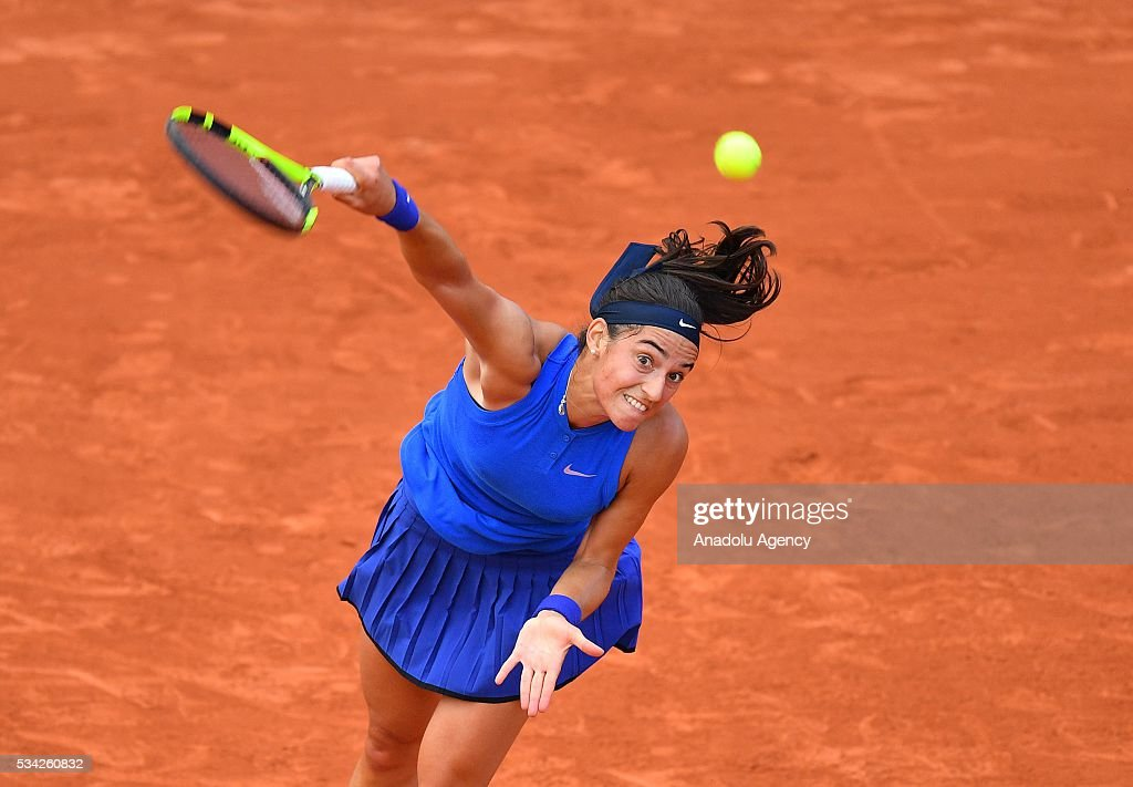Caroline Garcia of France serves to Agnieszka Radwanska (not seen) of Poland during their women's single second round at the French Open tennis tournament at Roland Garros in Paris, France on May 25, 2016.