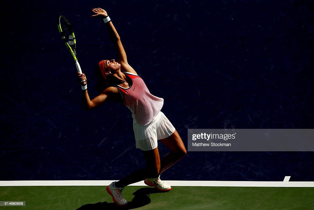 <a gi-track='captionPersonalityLinkClicked' href=/galleries/search?phrase=Caroline+Garcia&family=editorial&specificpeople=6605758 ng-click='$event.stopPropagation()'>Caroline Garcia</a> of France serves to Christina McHale during the BNP Paribas Open at the Indian Wells Tennis Garden on March 10, 2016 in Indian Wells, California.