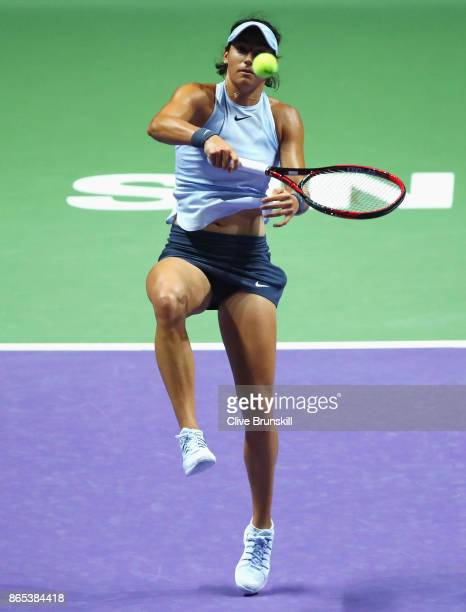Caroline Garcia of France smashes in her singles match against Simona Halep of Romania during day 2 of the BNP Paribas WTA Finals Singapore presented...