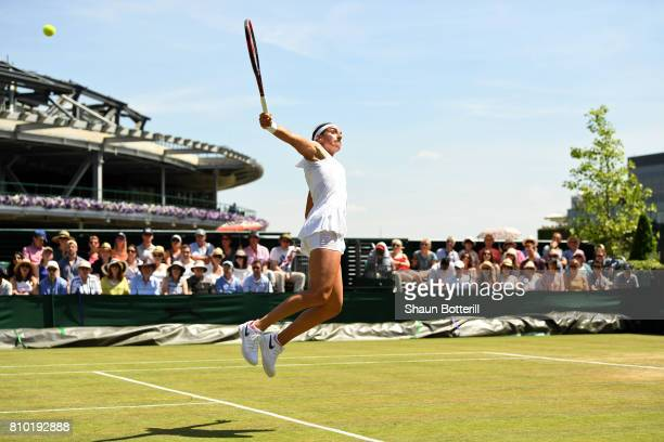 Caroline Garcia of France stretches to play a forehand shot during the Ladies Singles third round match against Madison Brengle of The Unites States...