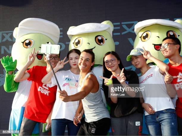 Caroline Garcia of France take a selfie with fans after a warm up exercise demonstration during Day 3 on September 26 2017 in Wuhan China