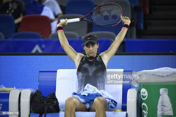 Caroline Garcia of France takes a rest in the third round women's singles match against Dominika Cibulkova of Slovakia at the WTA Wuhan Open tennis...