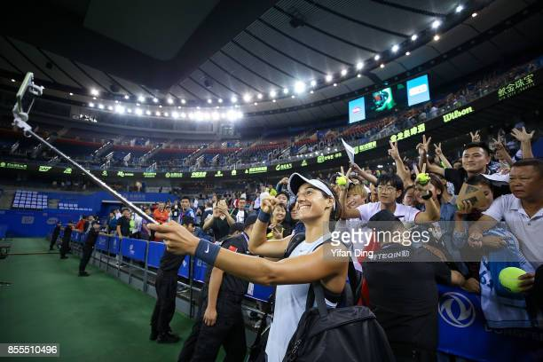 Caroline Garcia of France takes selfie with fans after winning the Ladies Singles semi final match between Maria Sakkari of Greece and Caroline...