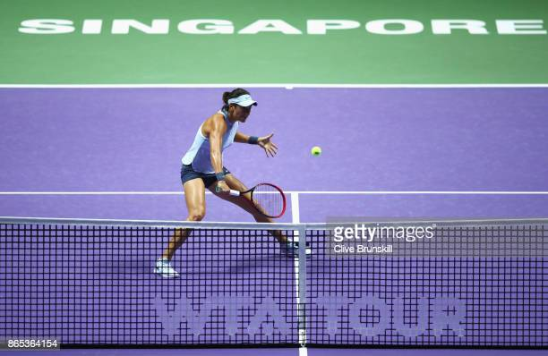 Caroline Garcia of France volleys in her singles match against Simona Halep of Romania during day 2 of the BNP Paribas WTA Finals Singapore presented...