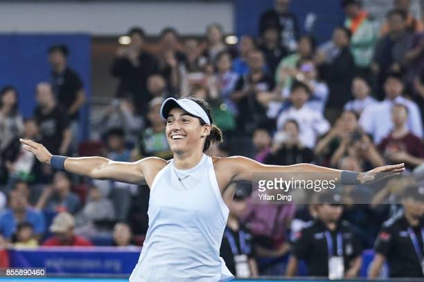 Caroline Garcia reacts after winning the ladies singles final between Ashleigh Barty of Australia and Caroline Garcia of France during Day 7of 2017...