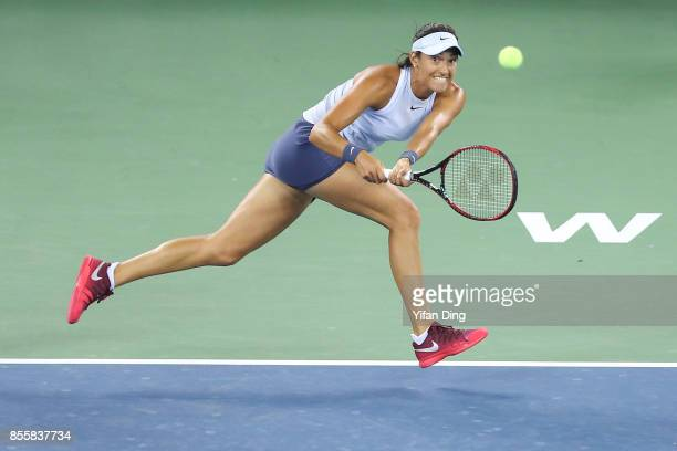 Caroline Garcia tries to return a shot during the ladies singles final between Ashleigh Barty of Australia and Caroline Garcia of France during Day...