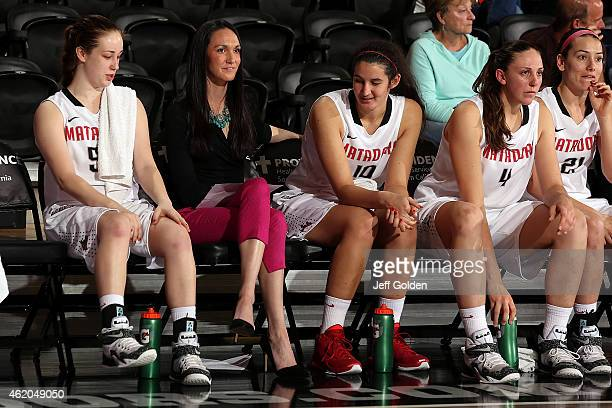 Caroline Gilling associate head coach Lindsey Foster Tessa Boagni Camille Mahlknecht and Travis Newman of the CSUN Matadors look on from the bench...