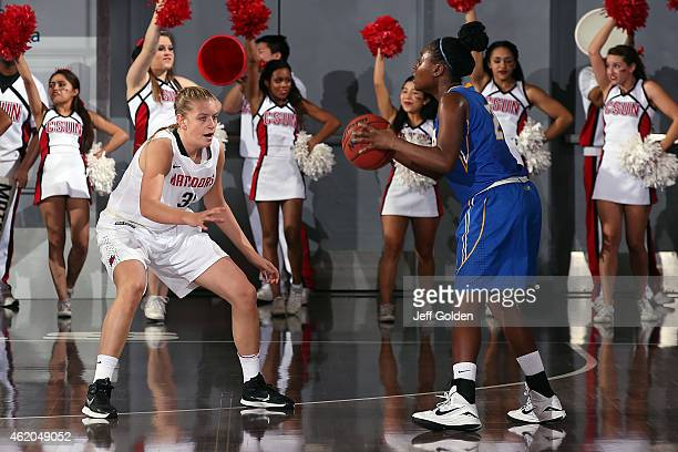 Caroline Gilling of the CSUN Matadors defends against Jasmine Ware of the UC Santa Barbara Gauchos in the first half at The Matadome on January 15...
