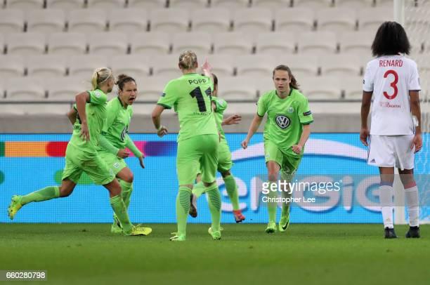 Caroline Graham Hansen of VFL Wolfsberg celebrates scoring their first goal during the Women's Champions League match between Lyon and Wolfsburg at...