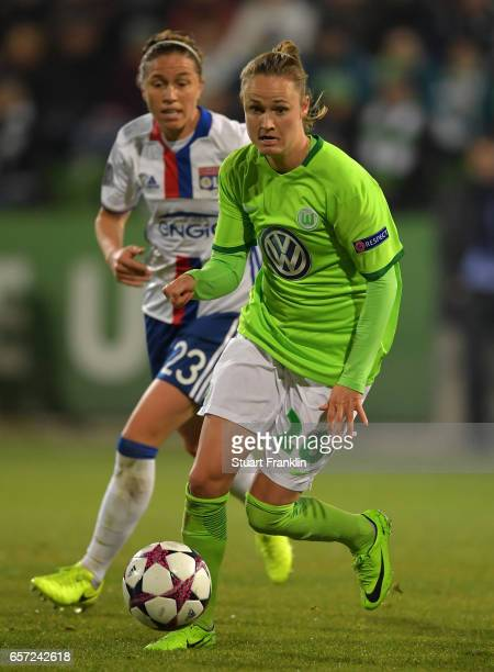 Caroline Graham Hansen of Wolfsburg is challenged by Camille Abily of Lyon during the UEFA Women's Champions League Quater Final first leg match...