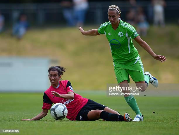 Caroline Hamann of Essen and Lena Goessling of Wolfsburg battle for the ball during the Women's Bundesliga match between SG EssenSchoenebeck and VfL...