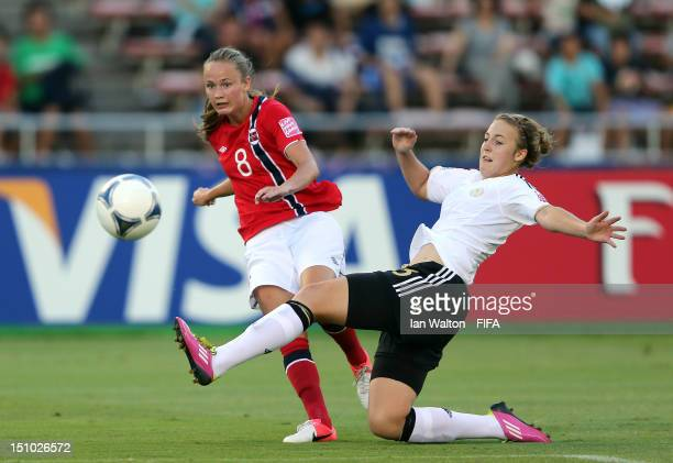 Caroline Hansen of Norway is tackled by Carolin Simon of Germany during the FIFA U20 Women's World Cup QuarterFinal match between Germany and Norway...