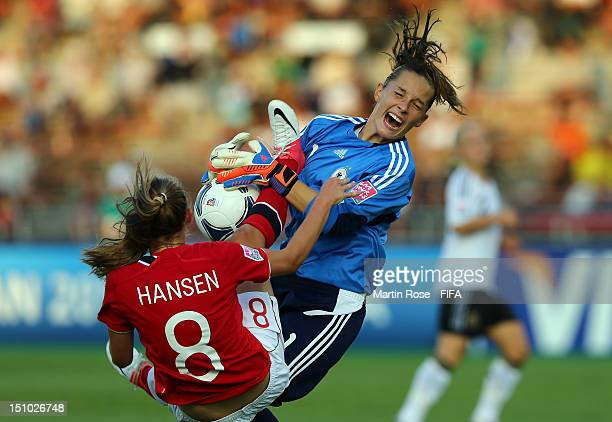 Caroline Hansen of Norway tackles Laura Benkarth goalkeeper of Germany during the FIFA U20 Women's World Cup Japan 2012 Quarter Final match between...