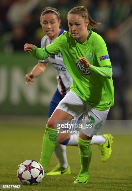 Caroline Hansen of Wolfsburg is challenged by Camile Abily of Lyon during the UEFA Women's Champions League Quater Final first leg match between VfL...