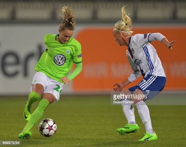 Caroline Hansen of Wolfsburg is challenged by Caroline Seger of Lyon during the UEFA Women's Champions League Quater Final first leg match between...