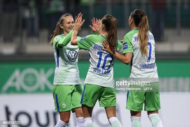 Caroline Hansenof Wolfsburg celebrates after scoring with Tessa Wullaert and Sara Bjork Gunnarsdottir of Wolfsburg during the UEFA Women Champions...