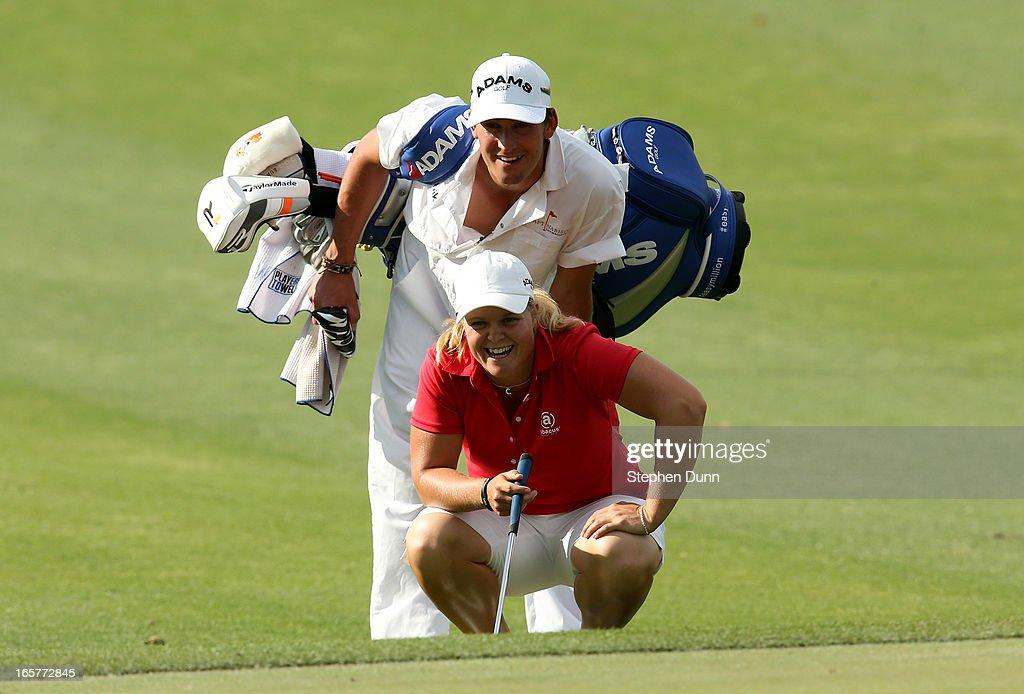 <a gi-track='captionPersonalityLinkClicked' href=/galleries/search?phrase=Caroline+Hedwall&family=editorial&specificpeople=4496797 ng-click='$event.stopPropagation()'>Caroline Hedwall</a> of Sweden and her caddie Henrik Hilford Brander have a laugh as they line up a shot on the second hole during the second round of the Kraft Nabisco Championship at Mission Hills Country Club on April 5, 2013 in Rancho Mirage, California.