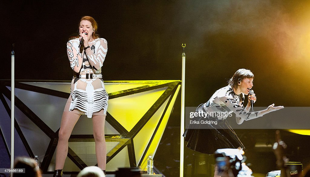 Caroline Hjelt and Aino Jawo of Icona Pop perform at Smoothie King Center on March 18 2014 in New Orleans Louisiana