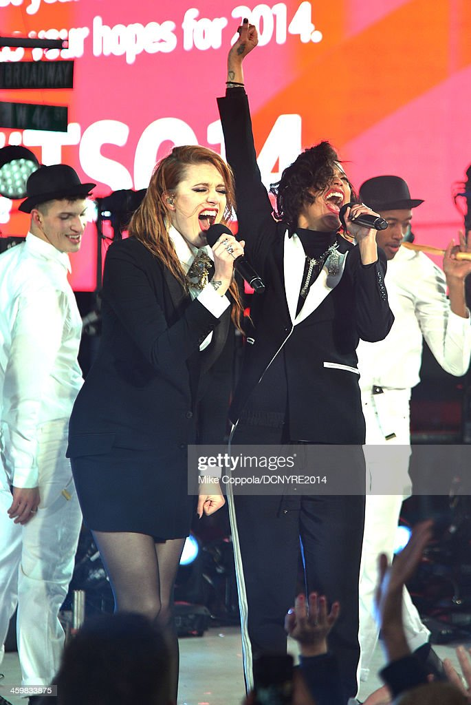 Caroline Hjelt and Aino Jawo of Icona Pop perform Dick Clark's New Year's Rockin' Eve with Ryan Seacrest 2014 on December 31 2013 in New York New York