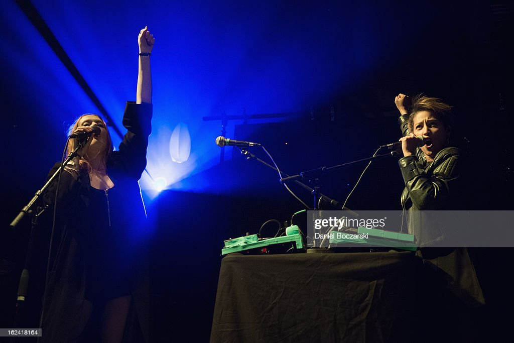 Caroline Hjelt (L) and Aino Jawo of Icona Pop perform on stage at UIC Pavilion on February 22, 2013 in Chicago, Illinois.