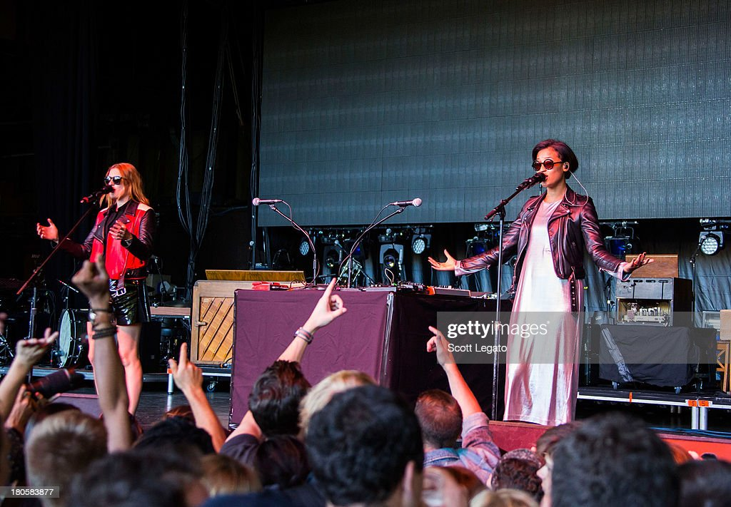 Caroline Hjelt (L) and Aino Jawo of Icona Pop performs during the St Jerome's Laneway Festival at Meadow Brook Music Festival on September 14, 2013 in Rochester, Michigan.