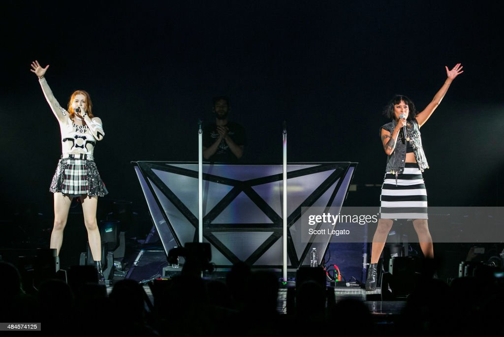 Caroline Hjelt (L) and Aino Jawo of Icona PopIcona Pop performs at The Palace of Auburn Hills on April 12, 2014 in Auburn Hills, Michigan.